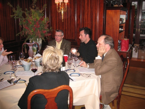Paul Grieco sitting with members of the Wine Media Guild